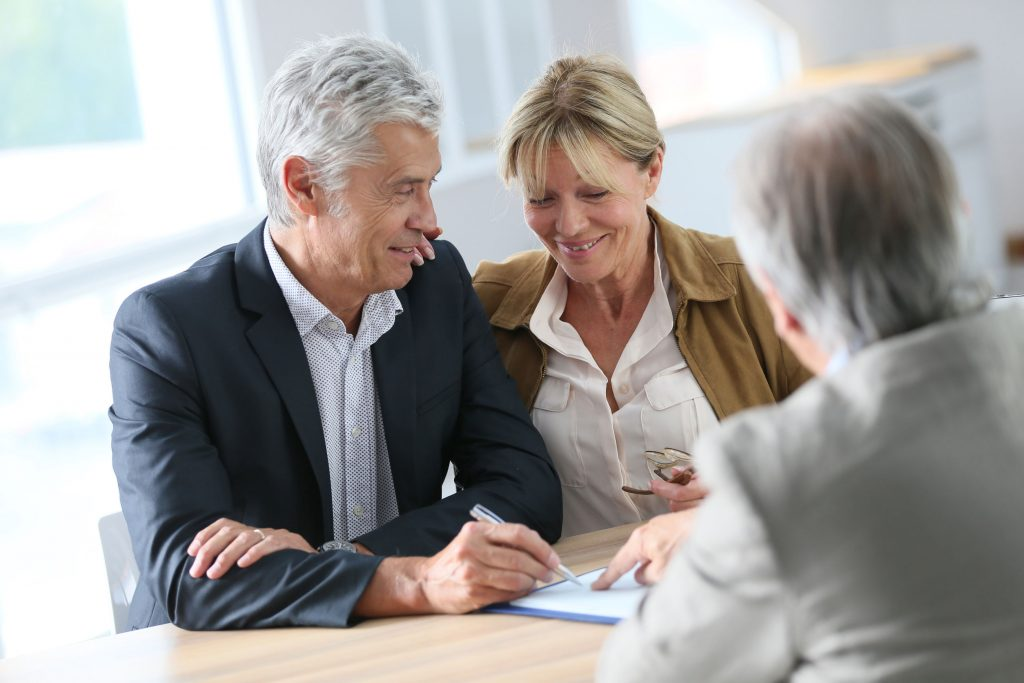 Senior couple meeting mortgage broker at express loan process