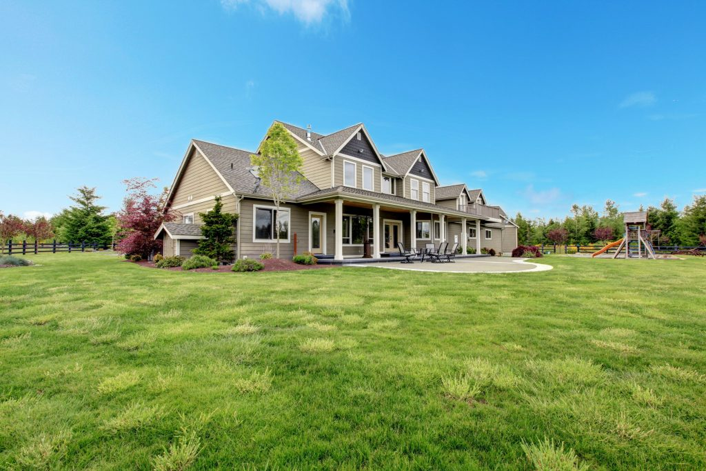large farm country house with spring green landscape, kids play ground.USDA Loan