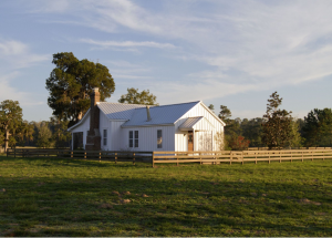Rural White Farmhouse purchased with a USDA Loan from Express Loan Process